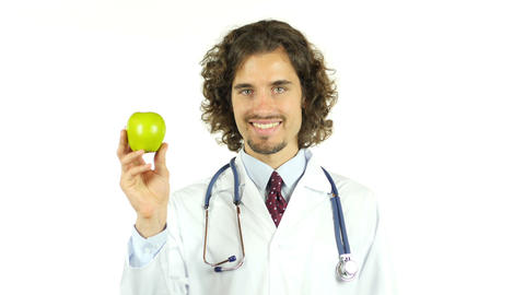 Professional doctor with green apple in hands Footage