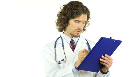 Doctor writing medical report in patient's clinical history, prescribing drugs Footage
