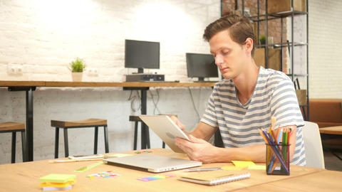 Man in office using Digital tablet PC, creative designer , agency Footage