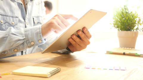 close up hands multitasking man using tablet at work Desk Footage
