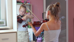 Young schoolgirl is practising playing viola Footage