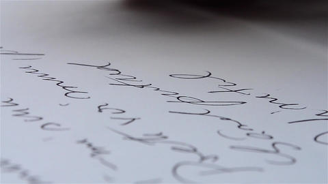 Man writes with a pen on a blank piece of paper 03 Footage
