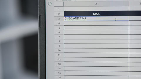 Person marking task CHEC AND FINALIZED AGENDA in online plan, to-do list Live Action