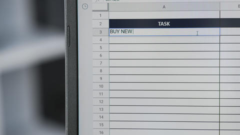 Person marking task BUY NEW BUSINESS SUIT in online plan, to-do list Live Action