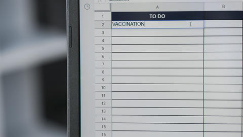 Person marking task VACCINATION in online plan, to-do list Live Action