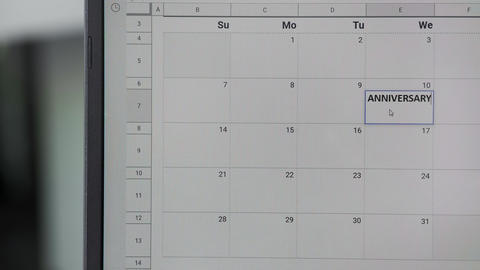 Writing ANNIVERSARY on 10th on calendar to remember this date GIF