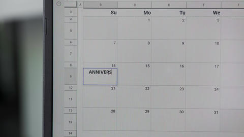 Writing ANNIVERSARY on 14th on calendar to remember this date ビデオ