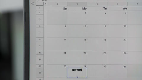 Writing BIRTHDAY on 29th on calendar to remember this date ビデオ