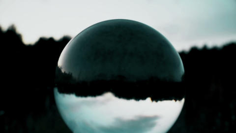 Getting dark, dusk, clouds passing reflection in crystal ball, horror scene Footage