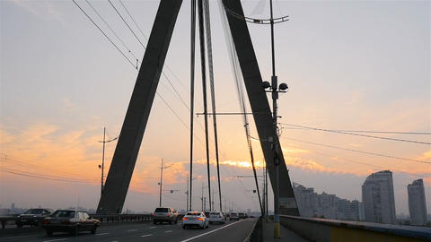 City landscape. The movement of cars on the bridge. Sunset. Beautiful and Footage