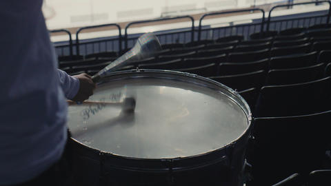 active man plays drum with sticks at sports match on stadium Footage
