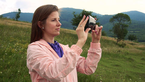 Woman making photos of beauty nature view Live Action
