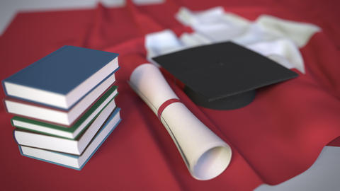 Graduation cap, books and diploma on the Swiss flag. Higher education in Footage