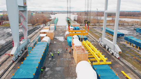 Cargo port - A big industrial crane loading the cargo on the freight carriage on Live Action