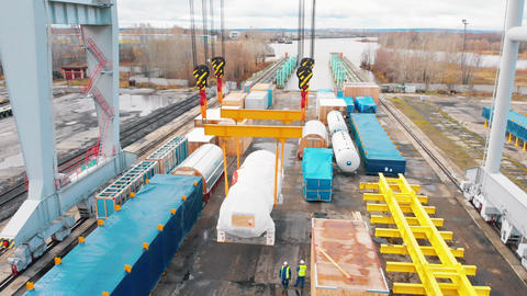 Cargo port - A big industrial crane moving the cargo in the air Live Action