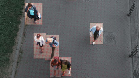 High view camera of people walking. Facial recognition interface scans personal Live Action