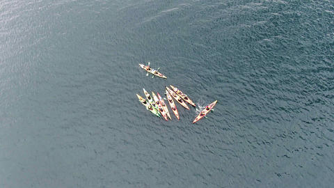 Aerial top view of kayak boat Tourist route several kayakers met among the sea Footage