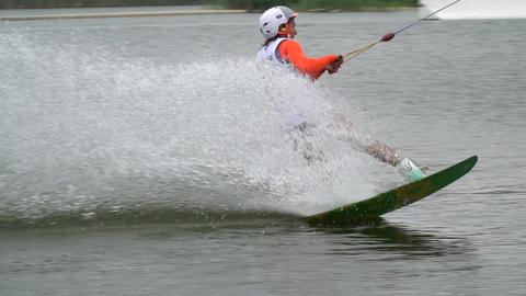 Wakeboarder woman is gliding on water, extreme water sport Live Action