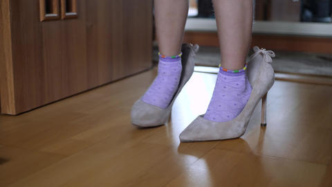 Legs of Small Girl Child in Adult Shoes with Heel Footage
