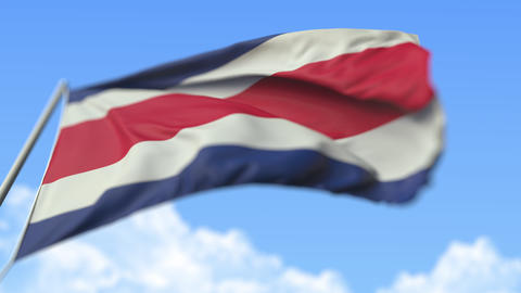 Flying national flag of Costa Rica, low angle view. Loopable realistic slow Live Action