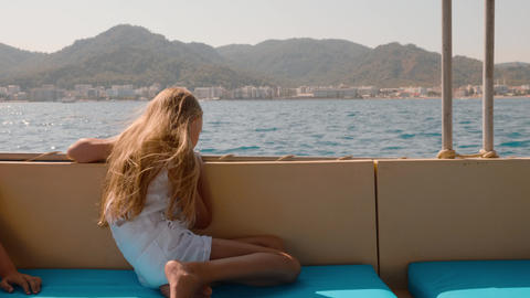 Tourist girl relaxing on sea walk on speed boat on mountain landscape. Traveling Live Action