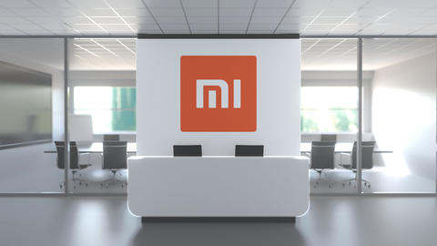 Modern office meeting room and reception with XIAOMI CORPORATION logo. Editorial Live Action