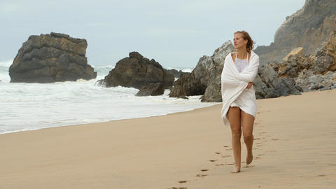 Walk along a sandy beach at the Ocean - Young woman on summer holiday Live Action