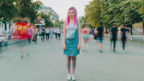 Time lapse of hipster girl with dyed hair and tattoo looking at camera outdoors Footage