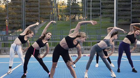 Group of young attractive women doing tiltes left to right on the fitness lesson Footage