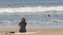 Female surfer sitting on the beach,Kuta,Bali,Indonesia Footage