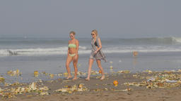 Rubbish of offerings after ceremony on beach,Kuta,Bali,Indonesia Footage