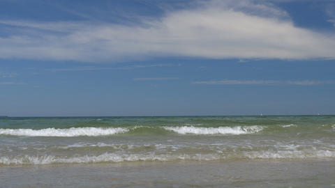 Beach scene with small waves. Peaceful and relaxing Footage