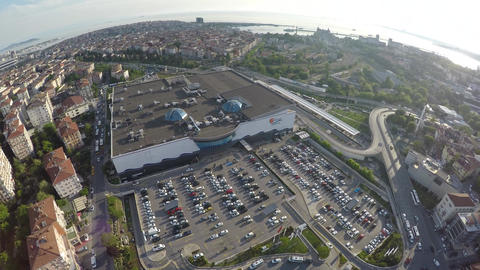 Aerial shot of shopping mall car parking with city view Footage