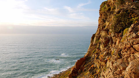 The rocky coast of Cape Roca in Portugal at the Atlantic Ocean Live Action