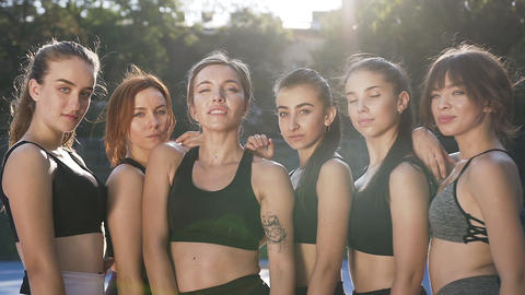 Satisfied happy slender athletic women looking at camera after fitness workout Footage