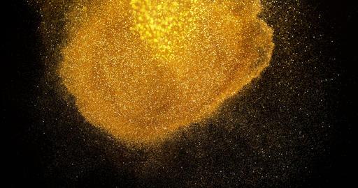 Gold Glitter Falling on Black Background, Slow Motion 4K Footage