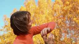 Happy woman dancing in autumn park. Beautiful woman training dance on outdoor Footage