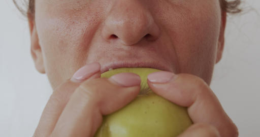 Woman eating apple, healthy eating, close-up lips Footage