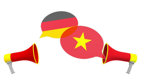 Flags of Vietnam and Germany on speech balloons from megaphones. Intercultural Live Action