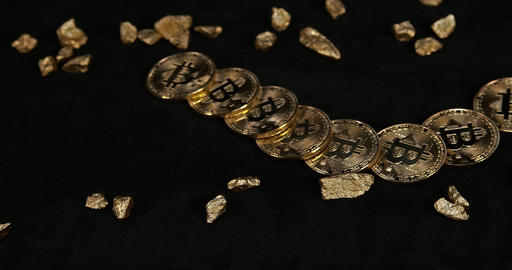Bitcoins and Gold Nuggets, Nugget, Falling on Black Background, Slow Motion 4K Footage