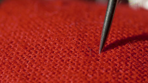 Needle pierces pillow for needles in macro Live Action