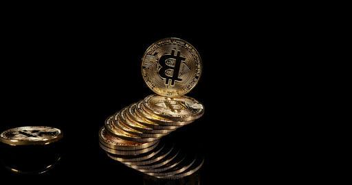 Bitcoins on Black Background, slow motion 4K Footage