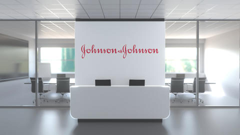 Logo of JOHNSON AND JOHNSON on a wall in the modern office, editorial conceptual Live Action