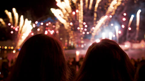 People look at the fireworks show on holiday in the evening at night Live Action