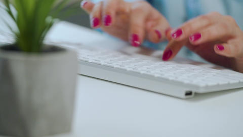 Female hands with bright manicure typing on a computer keyboard Footage