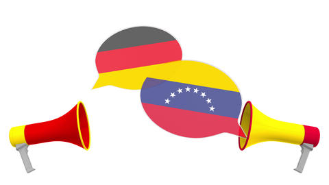 Speech bubbles with flags of Venezuela and Germany and loudspeakers Live Action