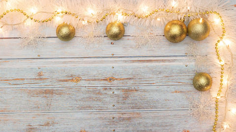 Beautiful gold and white Christmas decoration move on wooden table - Stop motion Animation