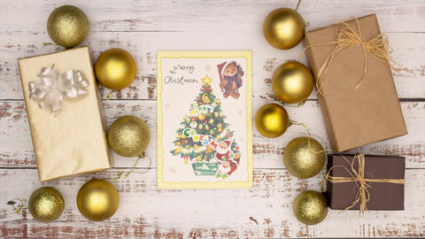 Beautiful gold Christmas decoration with Christmas card in the middle - Stop motion Animation