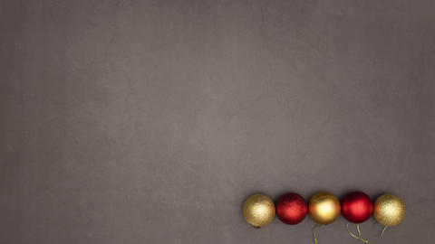 Christmas gold and red balls make Christmas tree with star on the top - Stop motion Animation