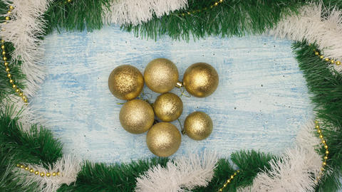 Christmas decoration of gold balls and garland on blue background - Stop motion CG動画